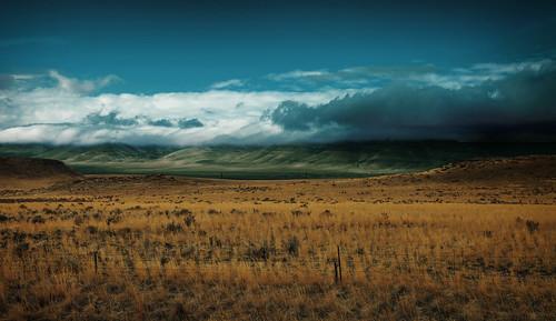 sky usa storm grass clouds america fence landscape unitedstates wideshot idaho american thunderstorm grassland barbwire stormclouds backroom