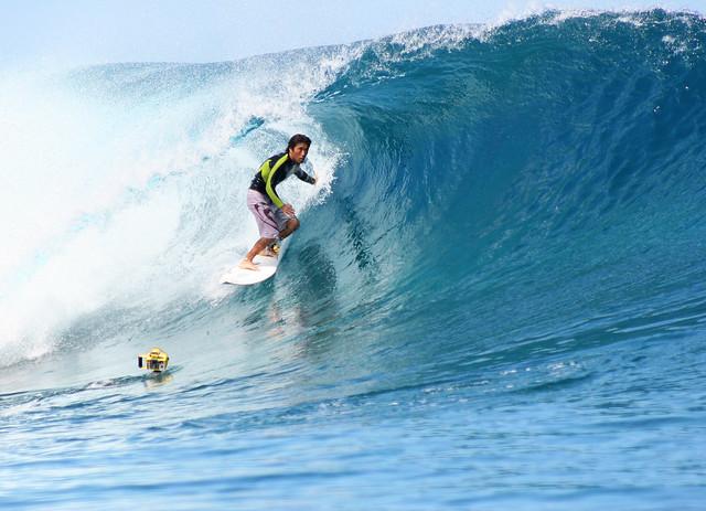 Surfing at Teahupoo, Tahiti.