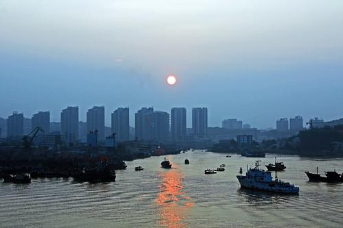 china city blue sea reflection water port sunrise boats bluesky sanya sunreflection southchina towerblocks sanyahainanisland