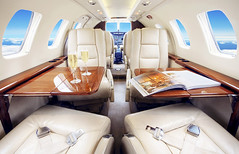luxury yacht(0.0), yacht(0.0), airline(1.0), aviation(1.0), vehicle(1.0), aircraft cabin(1.0), business jet(1.0),