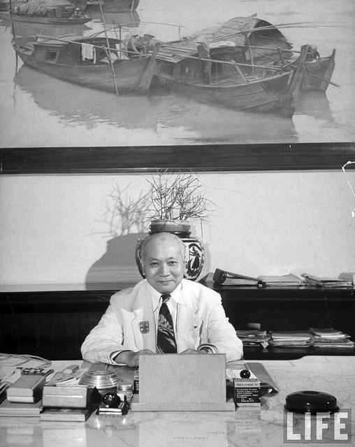 1948 -  Vietnam Premier, General Van Xuan Nguyen sitting at his desk.