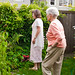 Small photo of Emiliy shows Grandmother her garden