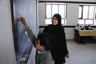 A teacher works with a hearing impaired student | by World Bank Photo Collection