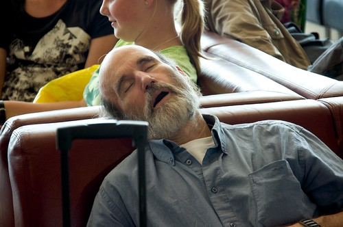sleeping man @ Schiphol airport