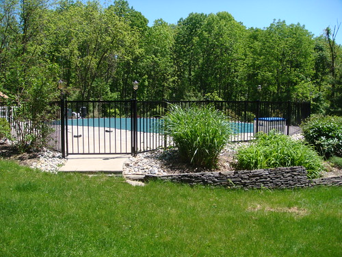 Life short landscaping ideas for around inground pools for Landscaping around pool