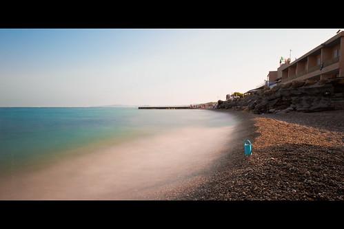 blue sea bw beach rock french bucket nikon long exposure riviera perspective des cote f28 villeneuve anges afs loubet baie dazur 2470mm nd110 d700 fabricedrevon