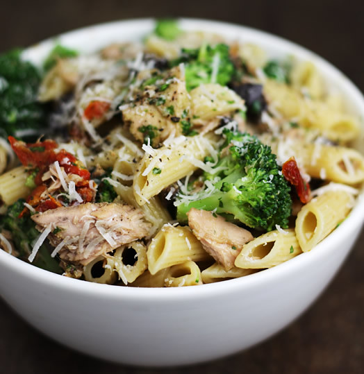 Pasta with tuna, olives, sun-dried tomatoes, basil, broccoli and ...