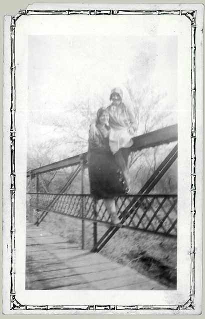 Two girls on a bridge