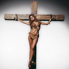 Raquel Welch, 'portrayal of how 1960s crucified the ideal of womanhood because it valued women only for their sexuality,' by Terry O'Neill 1970