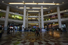 airport(0.0), airport terminal(0.0), plaza(0.0), building(1.0), outlet store(1.0), shopping mall(1.0), retail-store(1.0), infrastructure(1.0),