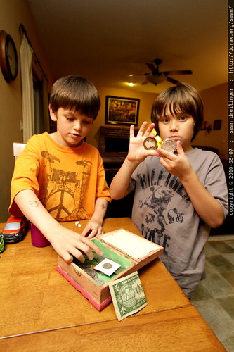 andrew showing nick his coin collection