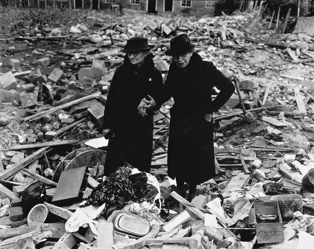 2 bewildered old ladies stand amid the leveled ruins of their home in Berkshire, England, by Naccarata 1943