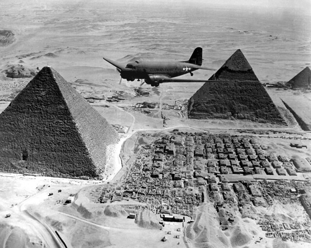 An Air Transport Command plane flies over the pyramids in Egypt, Africa campaign 1943