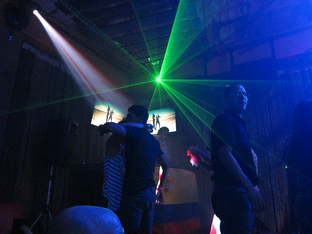 Green lasers shoot out from above the DJ booth.