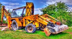 asphalt(0.0), agriculture(0.0), harvester(0.0), tractor(0.0), vehicle(1.0), construction equipment(1.0), bulldozer(1.0), land vehicle(1.0),