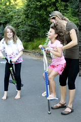 kelly helps her daughters pogo stick