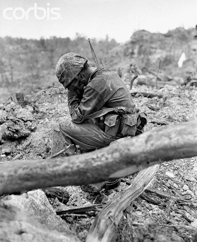 Soldier weeps after the savage battle for Hill 200 near Peleliu Airfield in 1944