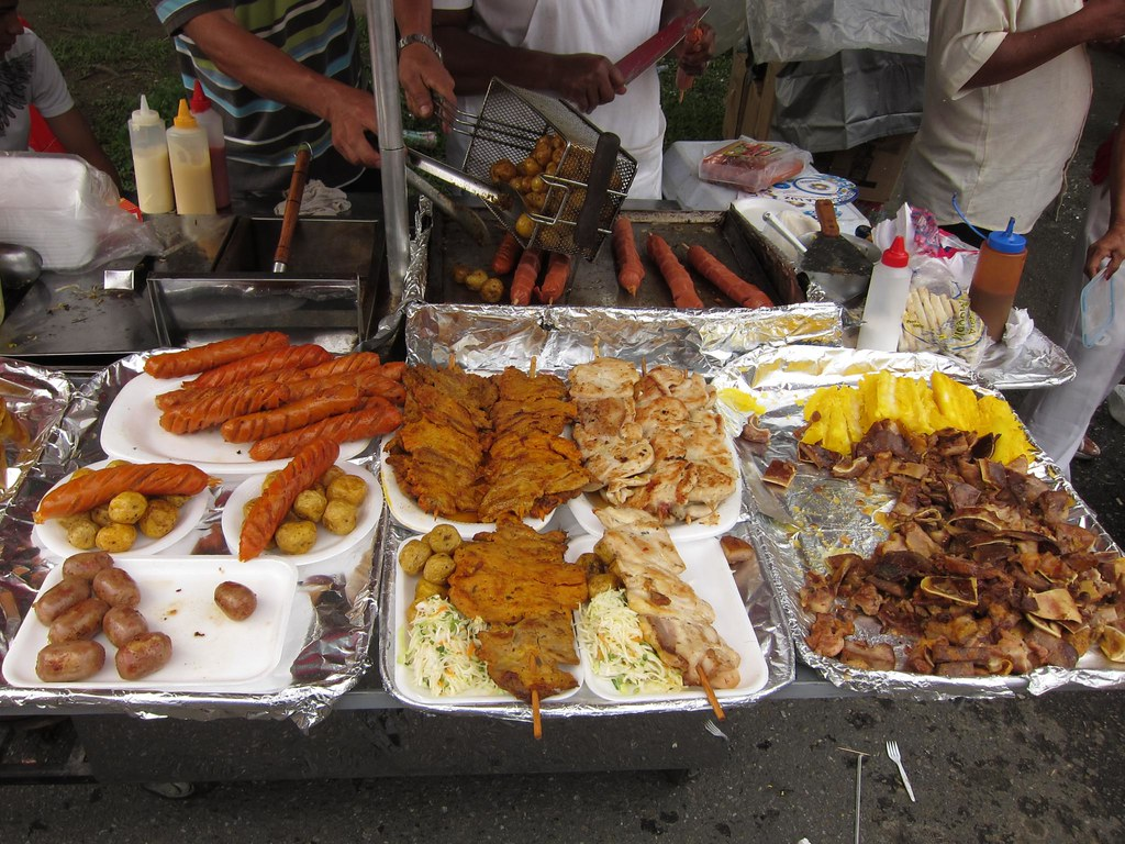 Chicken, meat, potatoes and salad make up the typical plate of street food in Colombia.  You'll find these combinations at every festival, parade and street party.