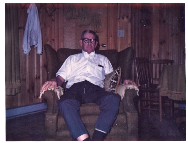 1960s man in glasses sitting in easy chair vintage photo for Sitting easy chairs