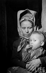 Refugee Lapland woman, known as a skolt, and her child pose for a picture during the Russo-Finnish War, by Carl Mydans 1944