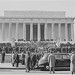 Photograph of the ceremony at the Lincoln Memorial commemorating Lincoln's birthday, with troops and spectators gathered on the steps of the Memorial., 02/12/1947
