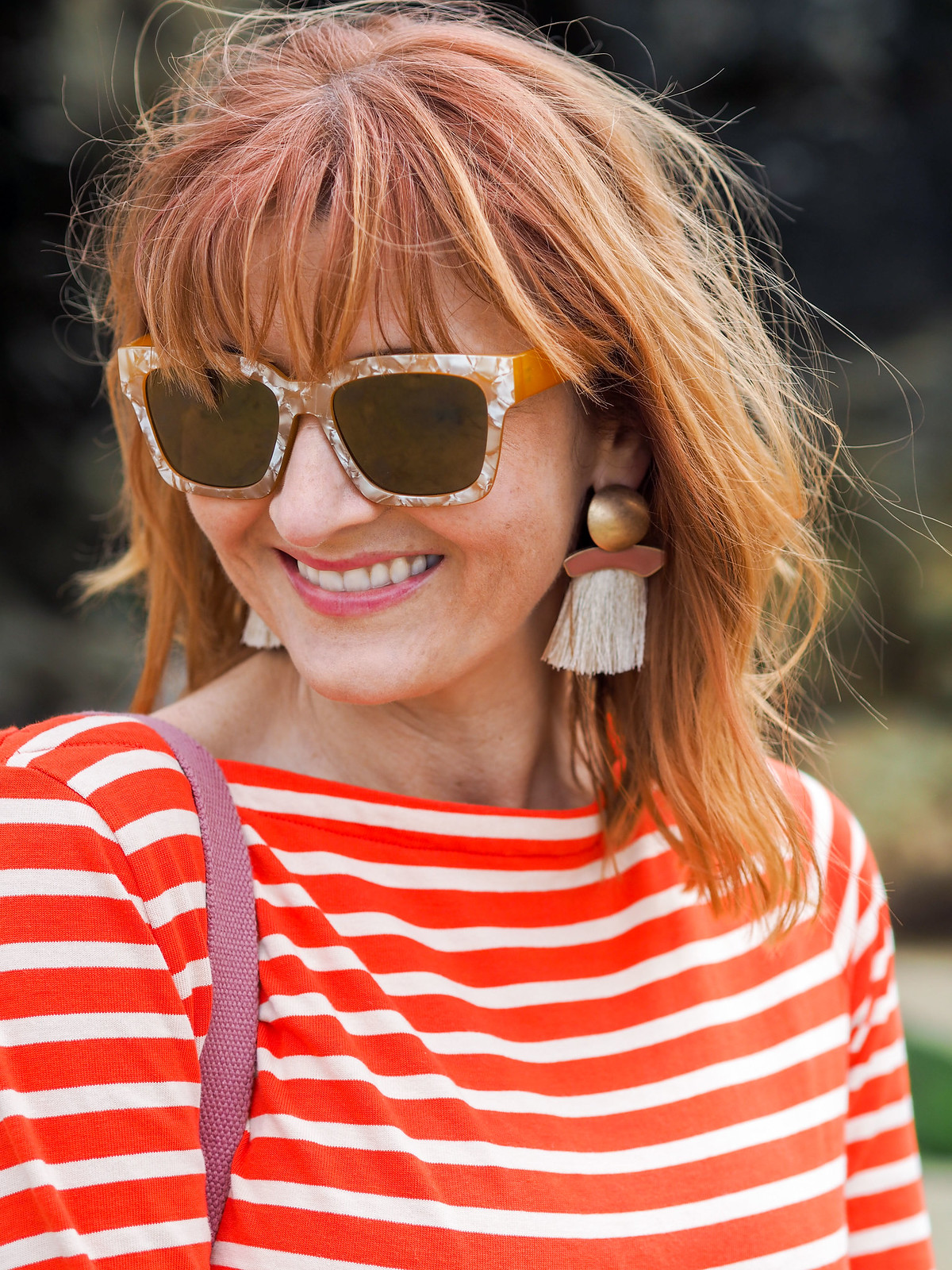 Mixing Breton stripes and florals: Orange Breton stripe top  cropped floral trousers pants  red lace-up espadrilles  pearl-effect square sunglasses  large tassel earrings | Not Dressed As Lamb, over 40 style