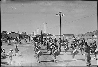Gila River Relocation Center, Rivers, Arizona. Girl Scouts Drum and Bugle Corp. participate in the 4th of July parade.