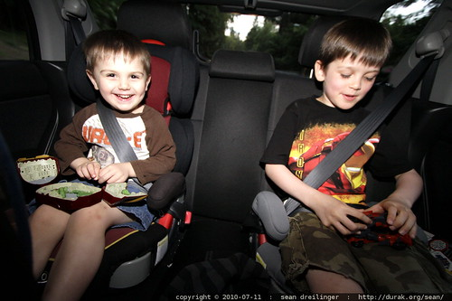 brothers reunite and exchange new toys in the back seat