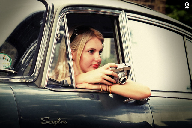 Girl, camera, car...