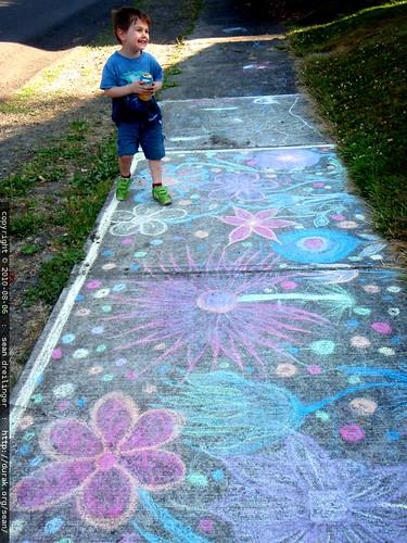 admiring the work of a fellow sidewalk chalk artist   P8060046