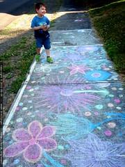 admiring the work of a fellow sidewalk chalk artist …
