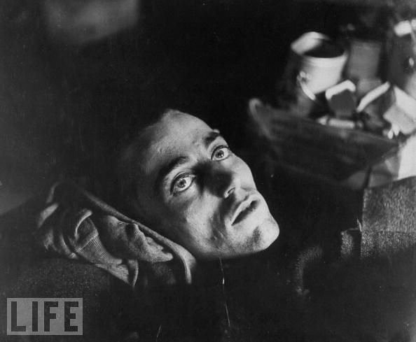 haunting stare of an emaciated American war prisoner as he lies on cot like death, by John Florea 1945