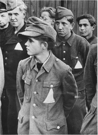 Very young German prisoners face to face, Normandy, France, Sep 1944, by Leonard McCombe