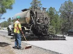 concrete mixer(0.0), asphalt(1.0), vehicle(1.0), construction equipment(1.0),