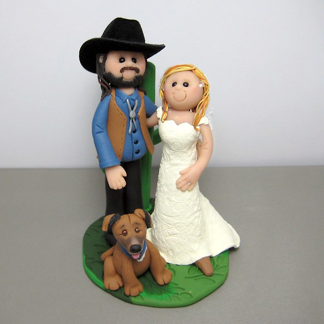 cowboy wedding cake topper Cowboy themed wedding with a cactus behind them