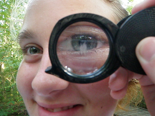 Lindsey, playing with the magnifying glass