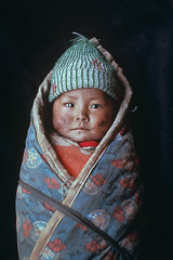 Child wrapped in blanket, Xigaze, Tibet, 1989, by Steve McCurry