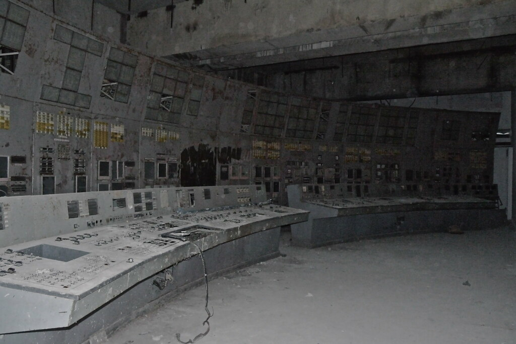 In an unlit room sits the control panels for Chernobyl's Reactor Four