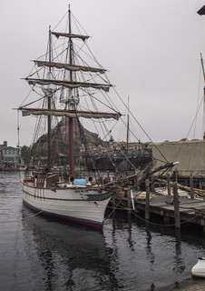 A tall ship near to the dock