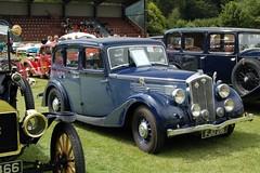 packard super eight(0.0), rolls-royce silver dawn(0.0), touring car(0.0), automobile(1.0), packard 120(1.0), rolls-royce phantom iii(1.0), vehicle(1.0), antique car(1.0), sedan(1.0), classic car(1.0), vintage car(1.0), land vehicle(1.0), luxury vehicle(1.0), motor vehicle(1.0), classic(1.0),