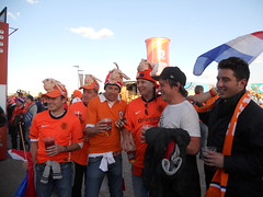 Dutch fans with slaughtered octopus on their heads, a warning to Paul if Netherlands lose tonight