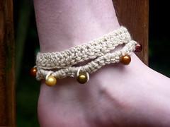 bracelet(0.0), necklace(0.0), art(1.0), yellow(1.0), pearl(1.0), jewellery(1.0), gemstone(1.0), bead(1.0),