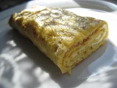 pastry(0.0), murtabak(0.0), produce(0.0), meal(1.0), breakfast(1.0), baked goods(1.0), food(1.0), dish(1.0), cuisine(1.0), tortilla de patatas(1.0), omelette(1.0),