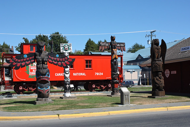 Caboose and totems at the depot, Duncan BC.  July 24 2010.