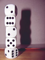 purple(0.0), recreation(0.0), number(0.0), pink(0.0), indoor games and sports(1.0), white(1.0), sports(1.0), tabletop game(1.0), games(1.0), dice(1.0), board game(1.0),