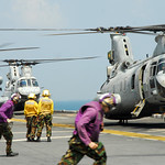 Sea Knight helicopters land aboard USS Essex.