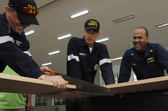 MANILA, Philippines (Feb. 15, 2011) Chief Religious Programs Specialist Tshombe Harris, right, a Sailor aboard 7th Fleet command ship USS Blue Ridge (LCC 19), helps Republic of the Philippines navy seabees cut wood to make beds for children at the Hospicio de San Jose. (U.S. Navy photo by Mass Communication Specialist 3rd Class Brian A. Stone)