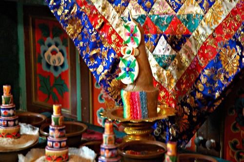 Silk deity cloth and torma set up (white Tara perhaps?), Tharlam Monastery of Tibetan Buddhism, Sakya Lamdre, Boudha, Kathmandu, Nepal by Wonderlane