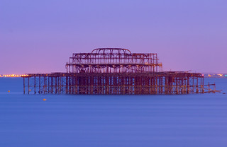 Image of West Pier. blue sea summer orange west water night coast pier iron brighton long exposure violet lilac nightime frame seafront remains silky