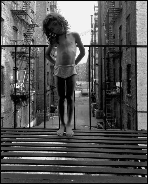 Girl in underwear standing on fire escape, by Bruce Davidson 1966
